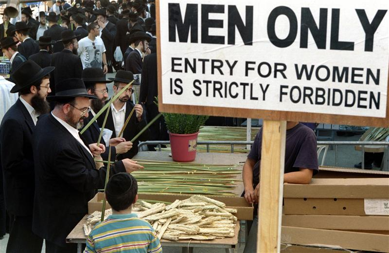 """Ultra-Orthodox Jews shop for the """"four species"""" in a special """"men's only"""" market in the religious ne.."""