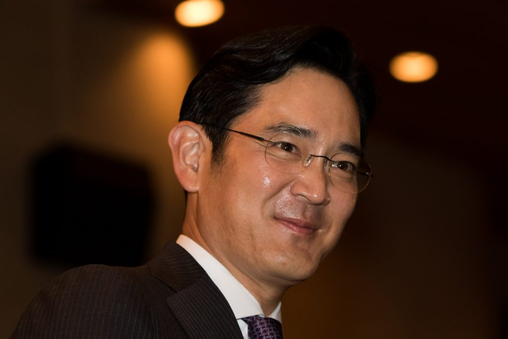 Billionaire Lee Jae Yong, vice chairman of Samsung Electronics Co., attends the Samsung Foundation's 2015 Ho-Am Prize ceremony in Seoul, South Korea, on Monday, June 1, 2015. In a deal announced last Tuesday, Cheil Industries Inc., Samsung Group's de facto holding company, will buy out construction affiliate Samsung C&T Corp. for about $9.2 billion in stock. The genius of the deal: Aside from generating about $25 billion in revenue, C&T holds more than $12 billion in other companies' shares, including crown jewel Samsung Electronics Co. Photographer: SeongJoon Cho/Bloomberg *** Local Caption *** Lee Jae Yong